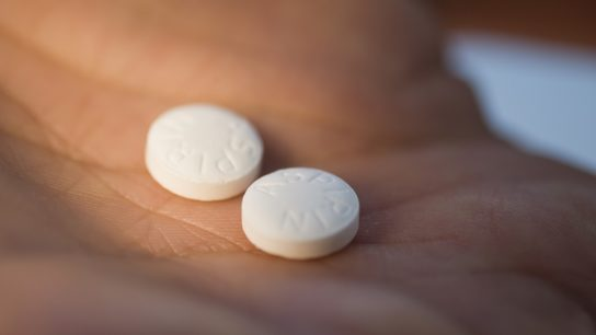 Aspirin in palm of hand