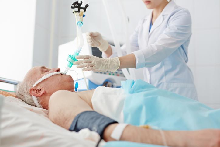 pneumonia patient in hospital bed