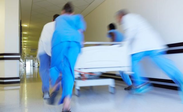 Physicians rushing a hospital patient to the emergency department