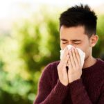 Man blowing nose, allergies, rhinitis
