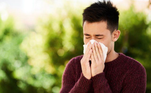 Man blowing nose, allergies, rhinitis