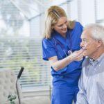 Elderly man receiving oxygen via cannula