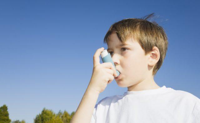 Pediatric asthma, child with inhaler