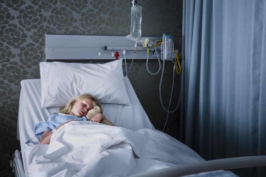 Young girl in hospital with pneumonia