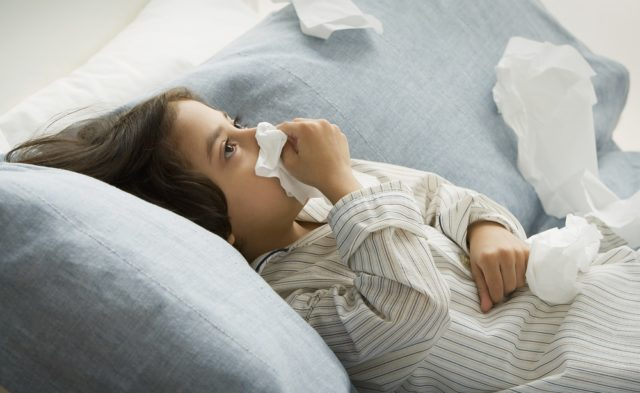 sick child, bed, blowing nose