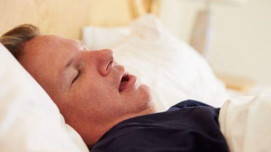 An overweight man sleeping