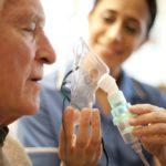 Elderly man using ventilator, COPD