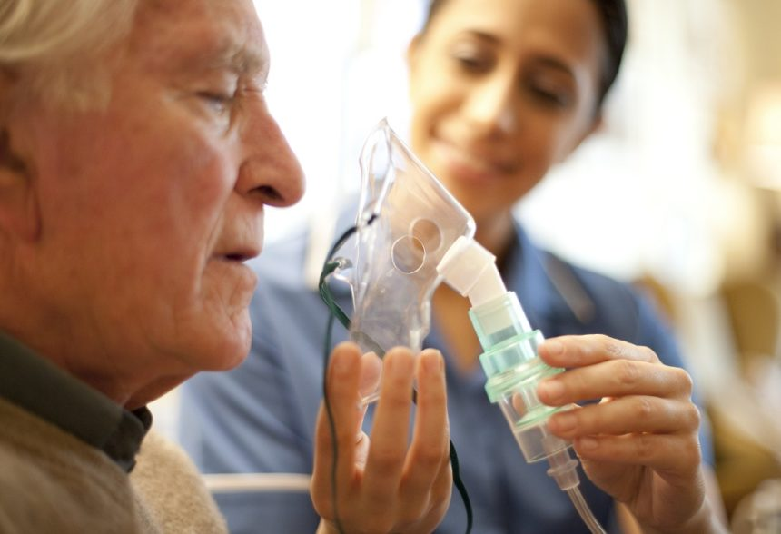 Elderly man using ventilator, COPD