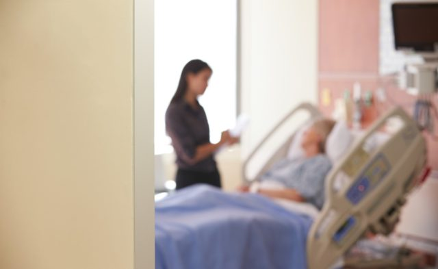 woman sitting hospital bed