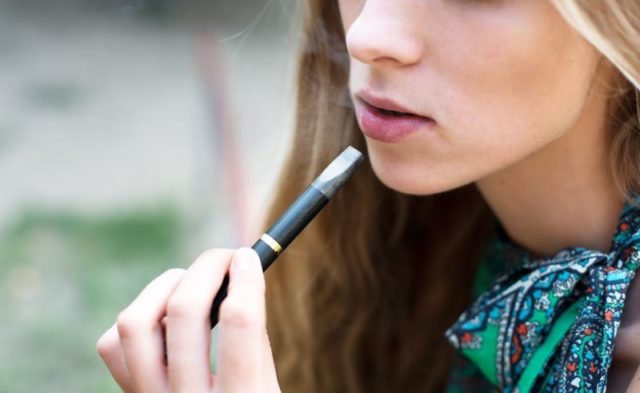 A woman using an electronic cigarette