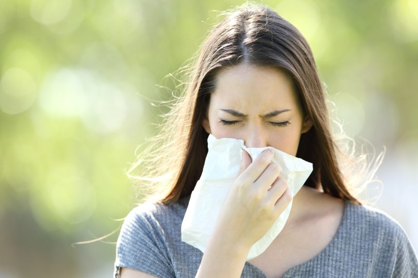 Girl blowing nose, allergic rhinitis, nasal congestion