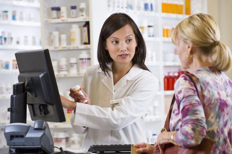 Pharmacist talking to customer
