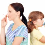 Woman smoking, child with asthma