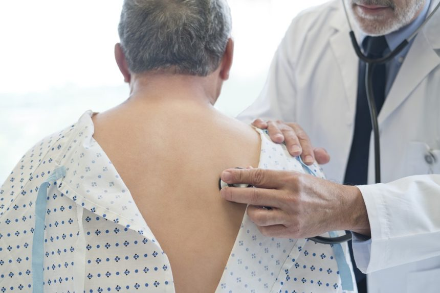 Doctor examining patients lungs, back, chest exam