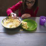 girl eating scrambled eggs, food allergies