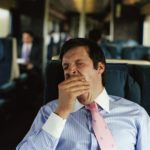 businessman yawning on train, sleepiness, tired, OSA