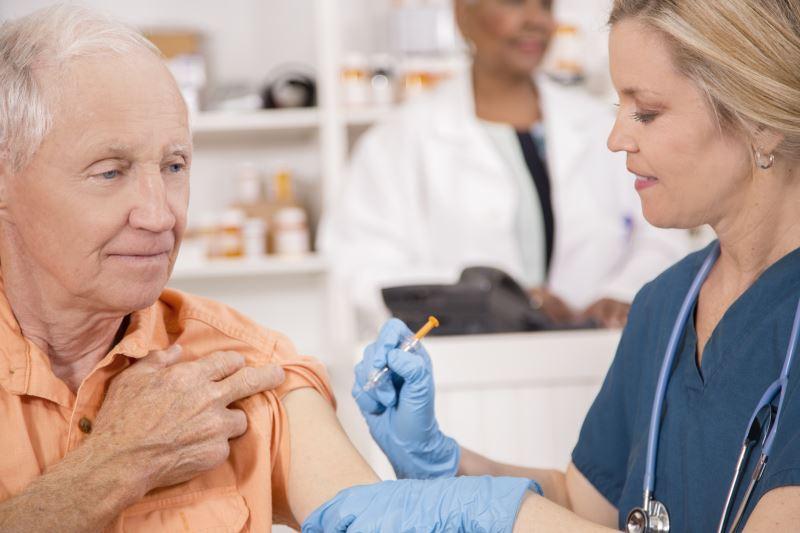 elderly man receiving influenza vaccine
