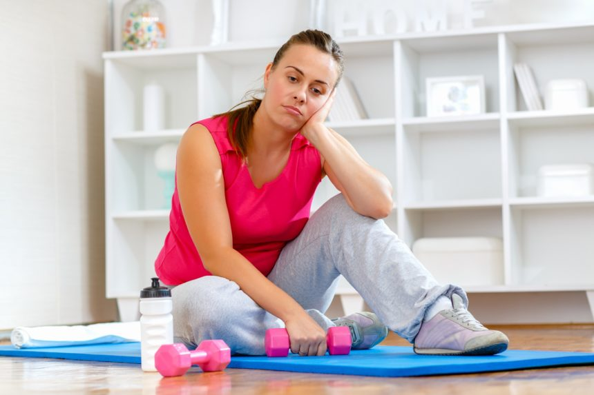 woman trying to exercise, struggling