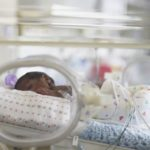 baby in incubator in neonatal intensive care unit