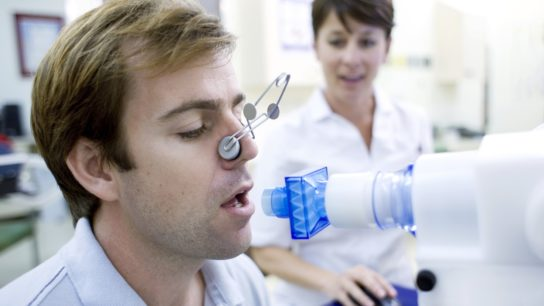 Man having a lung function test