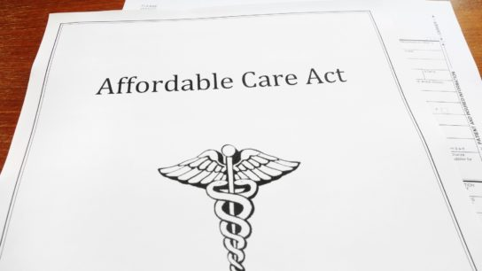 Stack of papers labeled Affordable Care Act