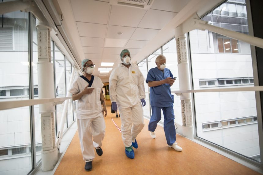 doctors walking down a hallway with masks on