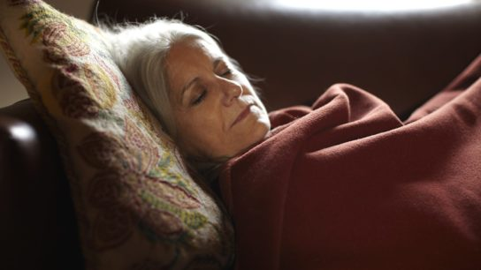 woman sleeping on couch